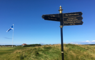 Sign post and flag at Trump Turnberry